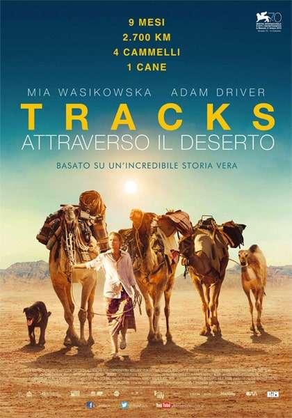 donna-in-viaggio-nel-deserto-con-4-cammelli-e-un-cane